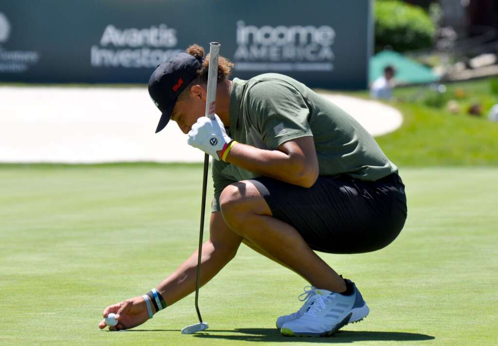NFL superstar Patrick Mahomes gets ready to putt.
