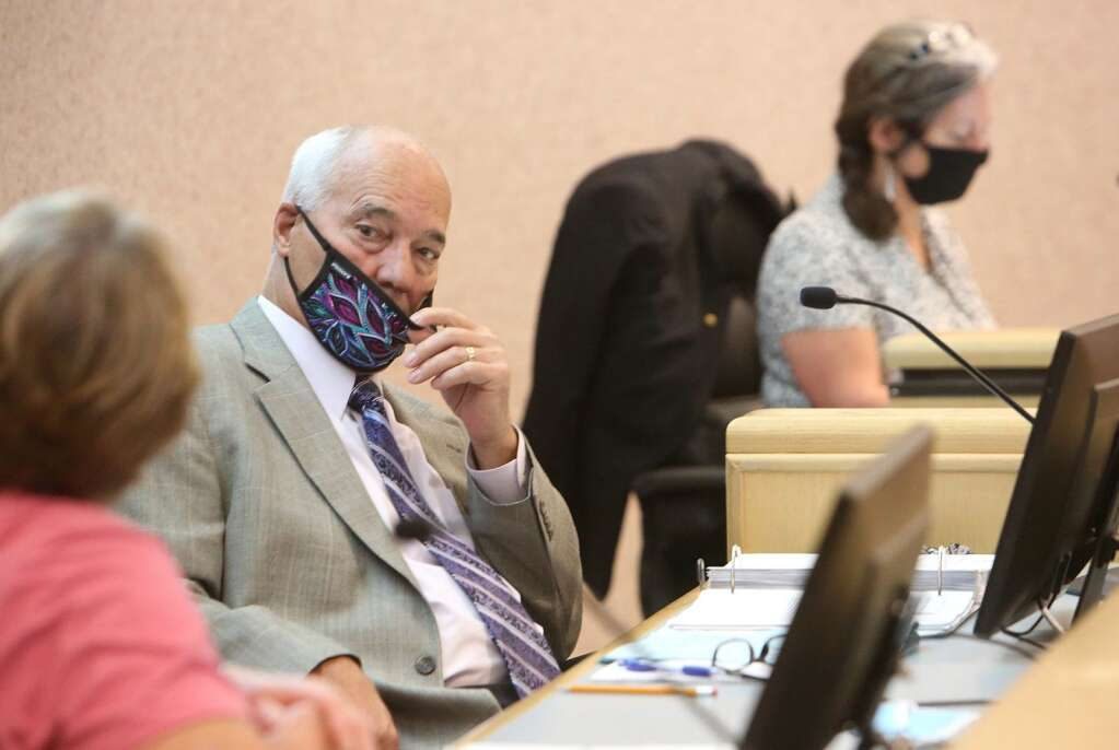 Nevada County Supervisor Dan Miller pulls his mask down below his nose during a June 23 Board of Supervisors meeting, the first publicly held meeting since the coronavirus shutdowns mid March.