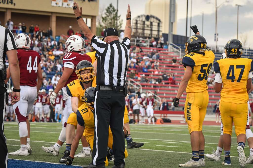The Rifle Bears react after a touchdown is confirmed during Saturday's 3A spring state title game at CSU Pueblo.  |Chelsea Self / Post Independent