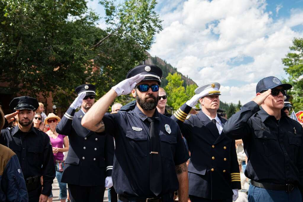 Uniformed personnel stand at attention during the 20th annual Day of Remembrance for 9/11 at Aspen Volunteer Fire Department on East Hopkins on Saturday, Sept. 11, 2021. (Kelsey Brunner/The Aspen Times)