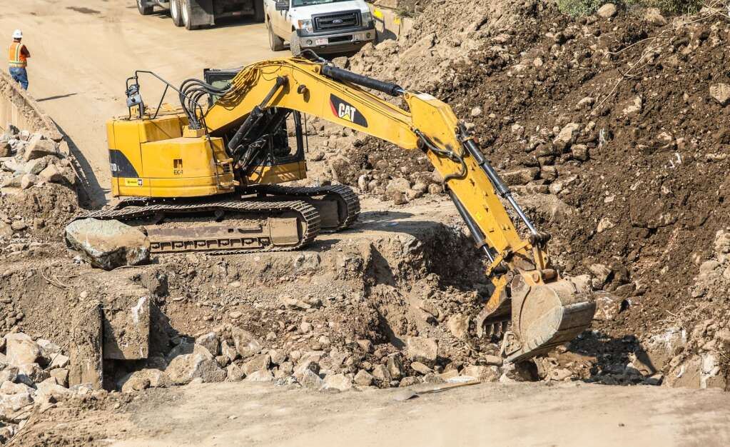 An excavator works to fill a hole in Interstate 70 Wednesday after a series of mud and rock slides decimated the interstate the end of July in Glenwood Canyon.   Chris Dillmann/cdillmann@vaildaily.com