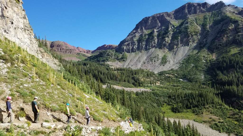 Volunteers walk in summer 2019 along a steep section of trail on North Maroon Peak that will be a work site this summer. | CFI/courtesy photo