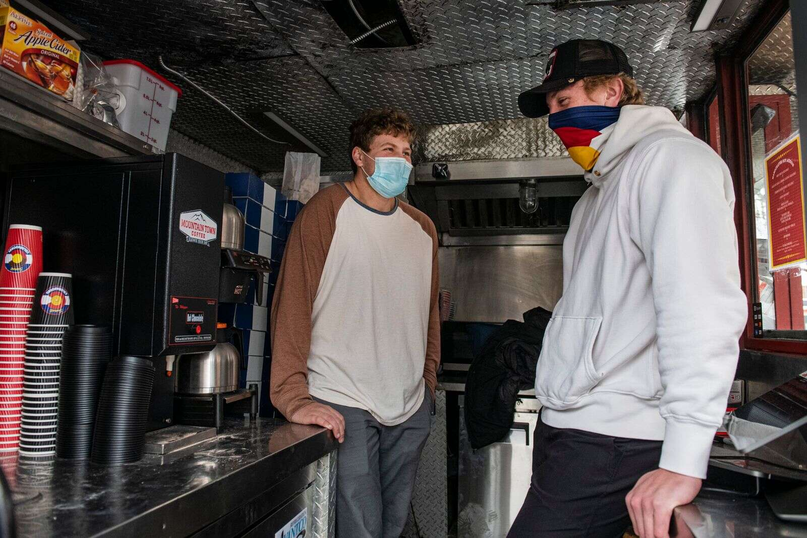 Zach Small, 17, and Eli Hunt, 17, stand in their new space where they will sell donuts and burritos in partnership with Coloradough in Aspen on Wednesday, Dec. 16, 2020. (Kelsey Brunner/The Aspen Times)