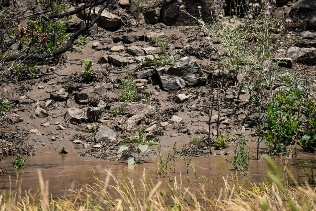 Mud sits in the median of Interstate 70 near MM 120 after a mudslide swept down the cliffs in Glenwood Canyon in the area of the Grizzly Creek burn scar on Sunday. |Chelsea Self / Post Independent