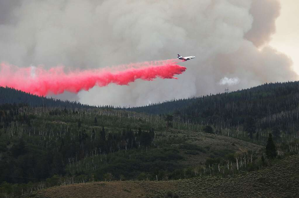 An air tanker drops fire retardant Wednesday afternoon on a portion of the Muddy Slide Fire. (Photo by John F. Russell)