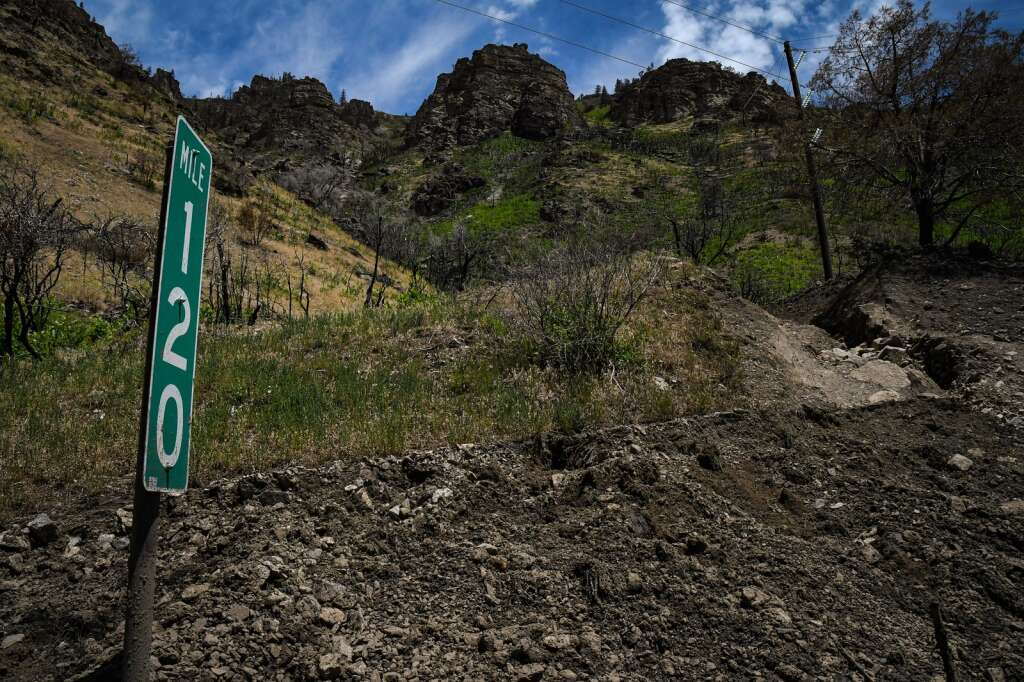 One of the multiple mud and debris slides on the westbound deck of Interstate 70 at MM120 after a mudslide swept down the cliffs in Glenwood Canyon in the area of the Grizzly Creek burn scar on Sunday. |Chelsea Self / Post Independent
