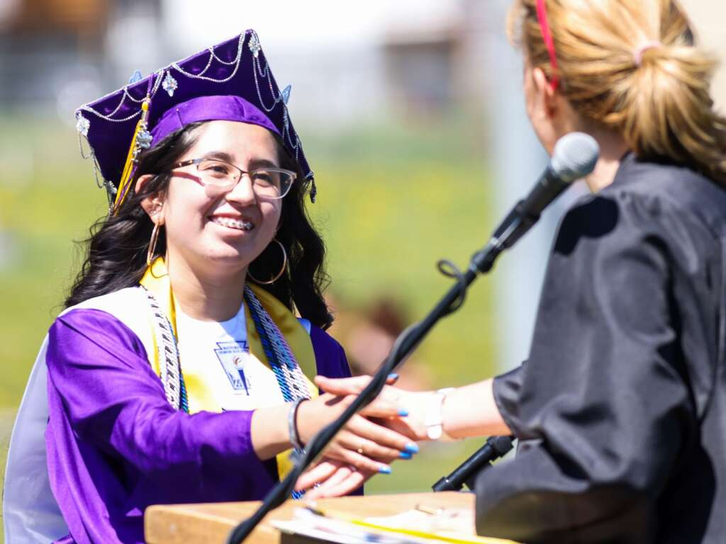 A student receives her diploma during the Basalt High School graduation ceremony on Saturday, May 22, 2021, on the BHS football field. Photo by Austin Colbert/The Aspen Times.