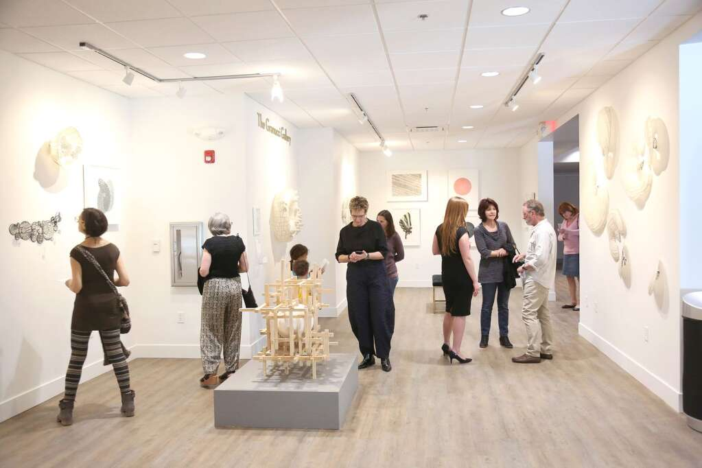 """Folks mingle about the 791 square feet Granucci Gallery space located inside of the newly re-opened The Center For the Arts in downtown Grass Valley. Artist Nancy Mintz christened the gallery with her show """"Strata"""" though the building would soon close to the public due to the mid March Covid-19 shutdown.   Photo: Elias Funez"""