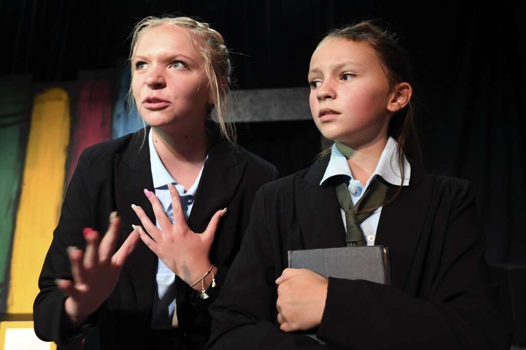 Sophie Feller, left, and Julianna Broughton perform during a dress rehearsal of the musical