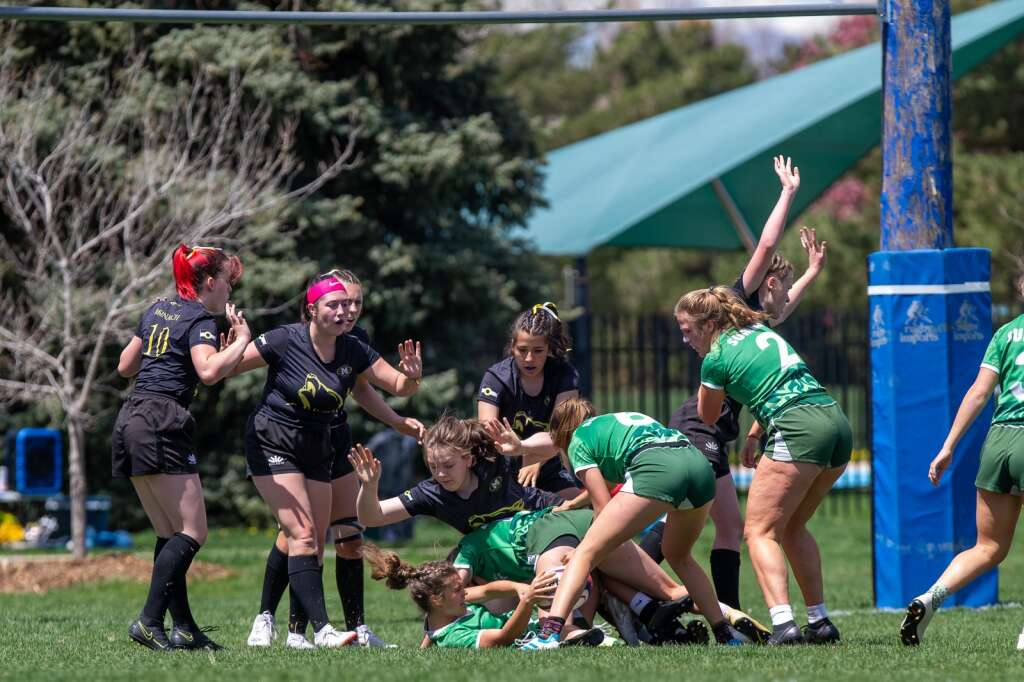 Bryton Ferrari, bottom, scrambles for the ball during play against Monarch at the high school rugby state championship on Saturday, May 1, 2021, at Cook Park in Denver. The Summit High girls rugby team won their 13th straight state championship title. | Photo by Liz Copan / Studio Copan