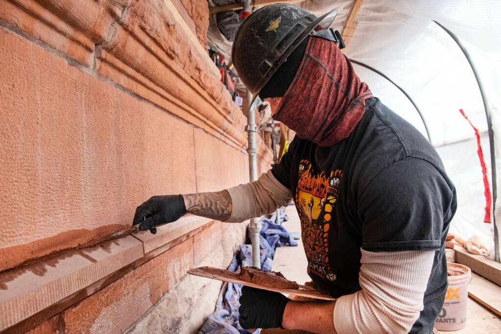 Stone technician Steve Jaco tuckpoints the sandstone on the replaced E-1 stones on the Wheeler Opera House in Aspen on Wednesday, March 24, 2021. (Kelsey Brunner/The Aspen Times)