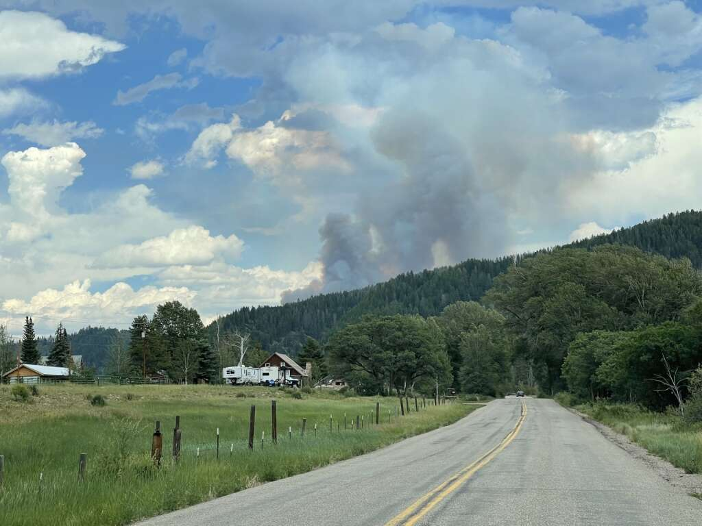 Smoke from a fire on Forest Service Road 442 can be seen from Seedhouse Road in North Routt. (Photo by Bryce Martin)
