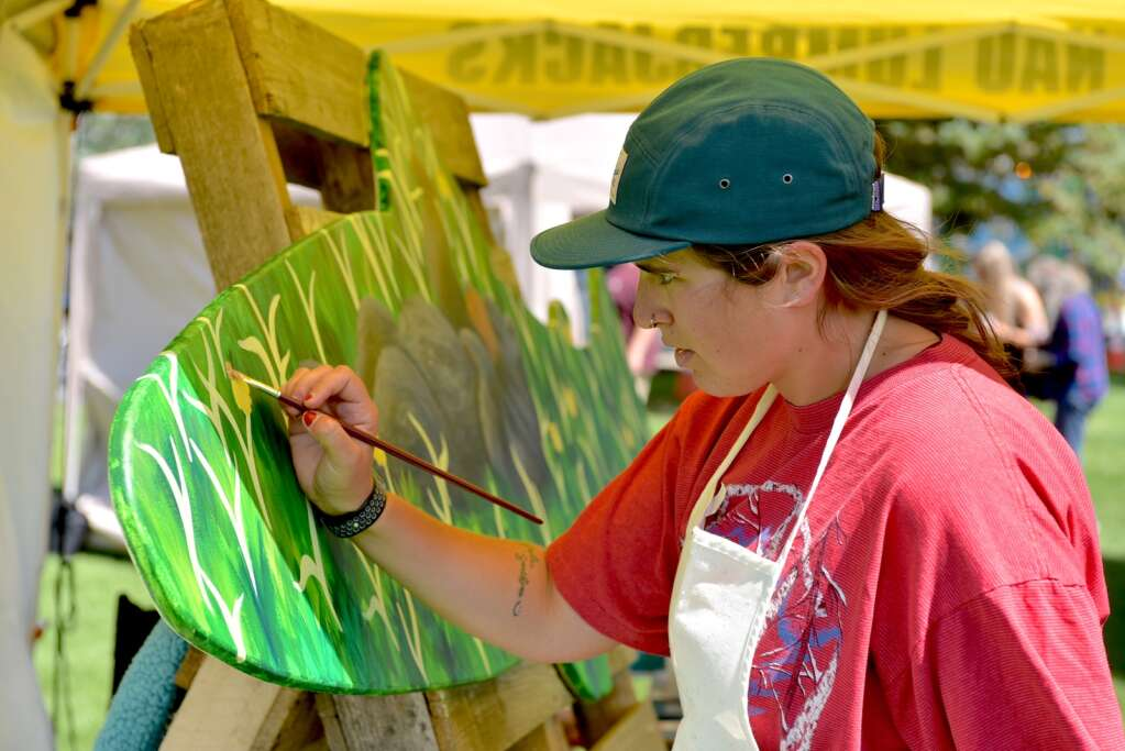 Mikey Cross finishes up details for her piece as part of Art in the Park on Saturday. Cross won third place for her art.   Amy Golden/Sky-Hi News