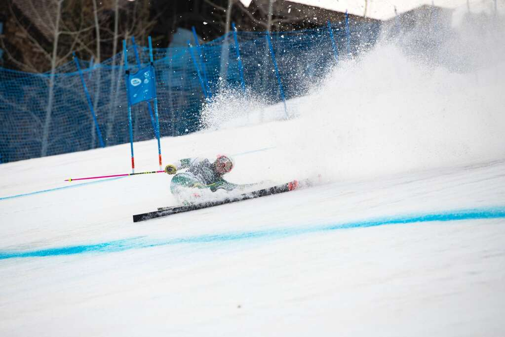 Australian skier Zoe Michael slides through the finish line after crashing during the Women's Giant Slalom National Championship at Aspen Highlands on Thursday, April 15, 2021. (Kelsey Brunner/The Aspen Times)