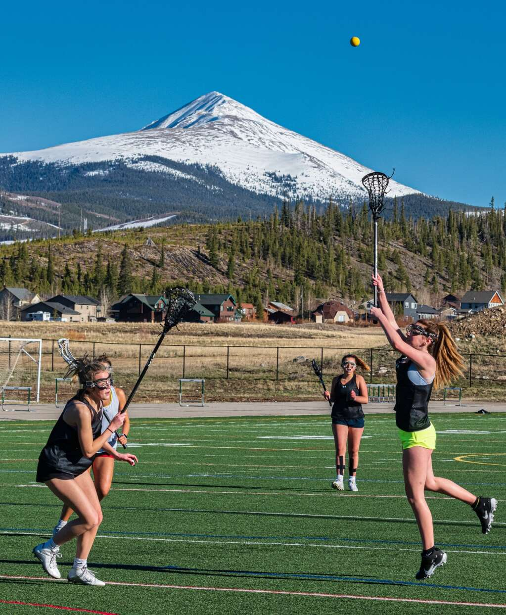 Kallie MacDonald, Caroline Fischer and Lindsay Davis practice with the Summit High School varsity girls lacrosse team at Tiger Stadium in Breckenridge on Thursday, May 6, 2021. | Photo by Joel Wexler / Rocky Mountain.Photography
