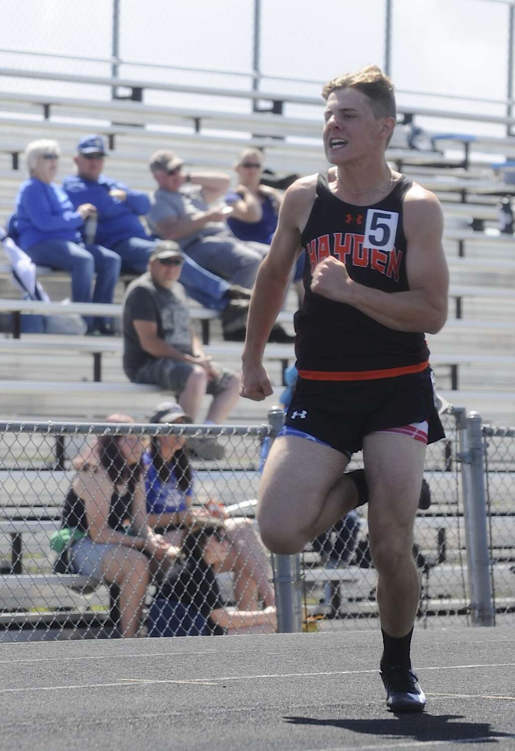 Hayden's Brayden Dale sprints in the 100-meter dash at the Clint Wells Invitational in Craig on Friday. (Photo by Shelby Reardon)