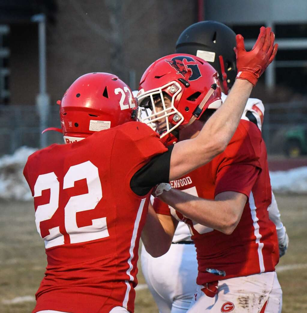 Two Glenwood Springs Demon celebrate after scoring early in the first quarter during Friday night's season opener against the Aspen Skiers. |Chelsea Self / Post Independent