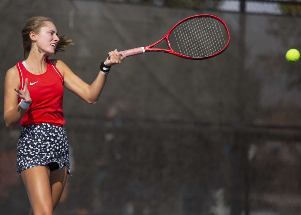 Park City High School junior Elle Martin returns a volley during her first singles matchup against Murray High School at the PC MARC Thursday afternoon, Sept. 23, 2021. (Tanzi Propst/Park Record)