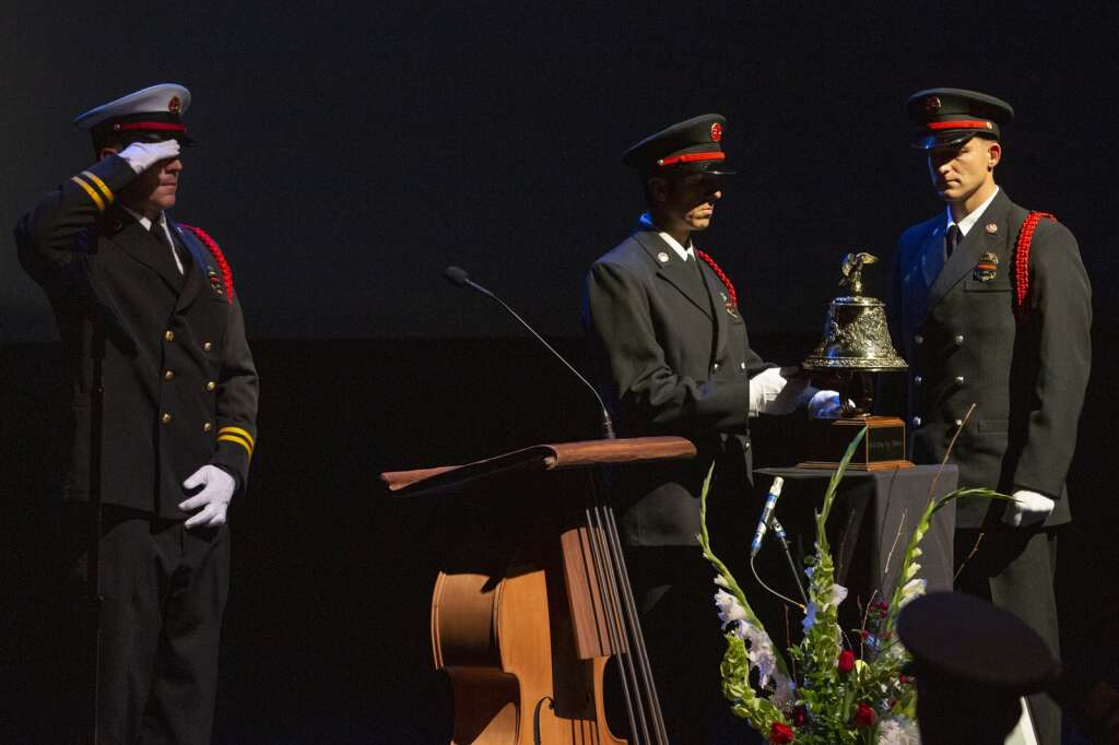 Firefighters perform a bell ceremony marking the end of late fire chief Paul Hewitt's service during a memorial service Thursday evening. | (Tanzi Propst/Park Record)