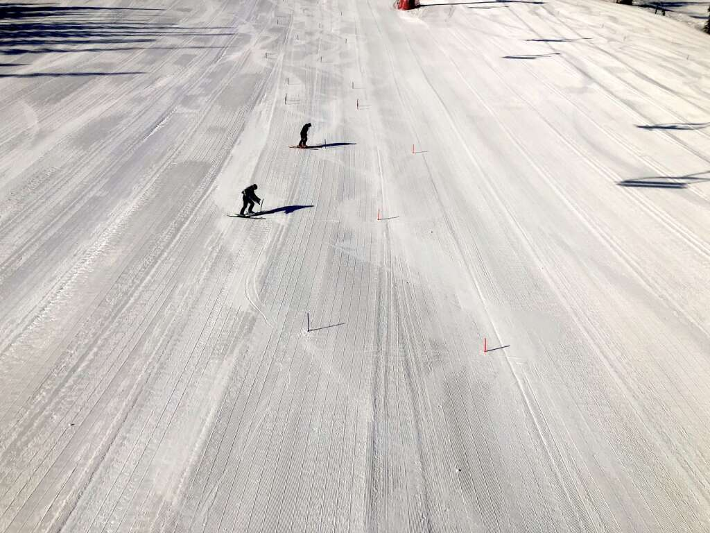 Staff prepare the race course before the slalom warm-up race at NASTAR national championships at Snowmass on April 5, 2021. | Kaya Williams/The Aspen Times