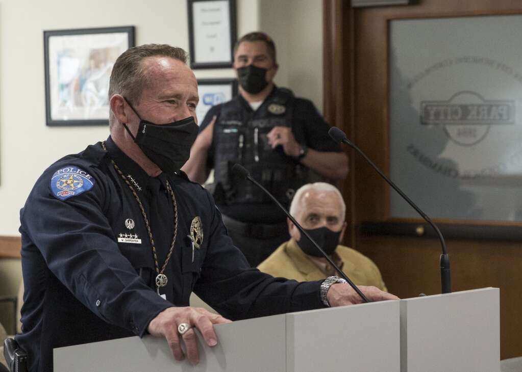 Park City Police Chief Wade Carpenter speaks at the podium during a council meeting prior to a swearing in ceremony for new officers Thursday evening, April 1, 2021. (Tanzi Propst/Park Record)