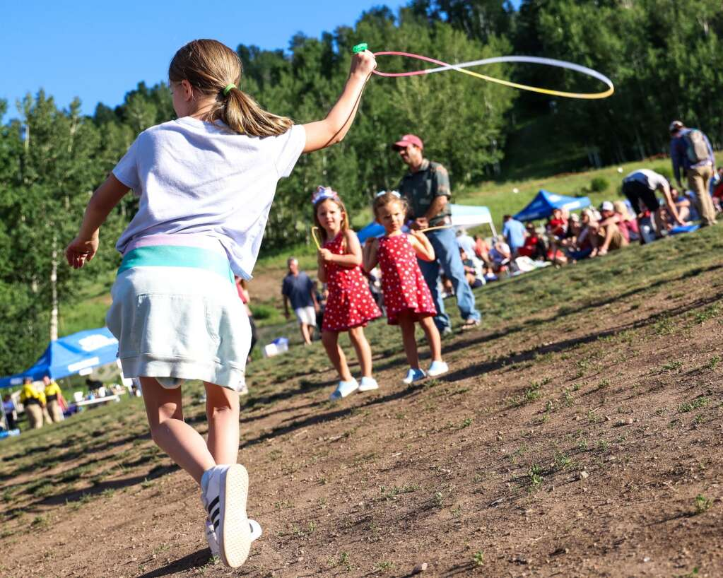 Children dance and listen as Miss Mojo, a funk band from New Orleans, performs a free concert on Sunday, July 4, 2021, on Fanny Hill in Snowmass Village.   Austin Colbert/The Snowmass Sun