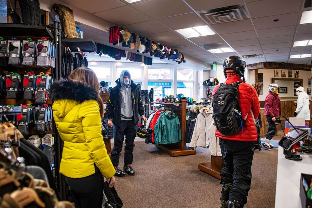 People shop in the Snowmass Sports store in Snowmass Village Mall on Tuesday, Dec. 29, 2020. (Kelsey Brunner/The Aspen Times)