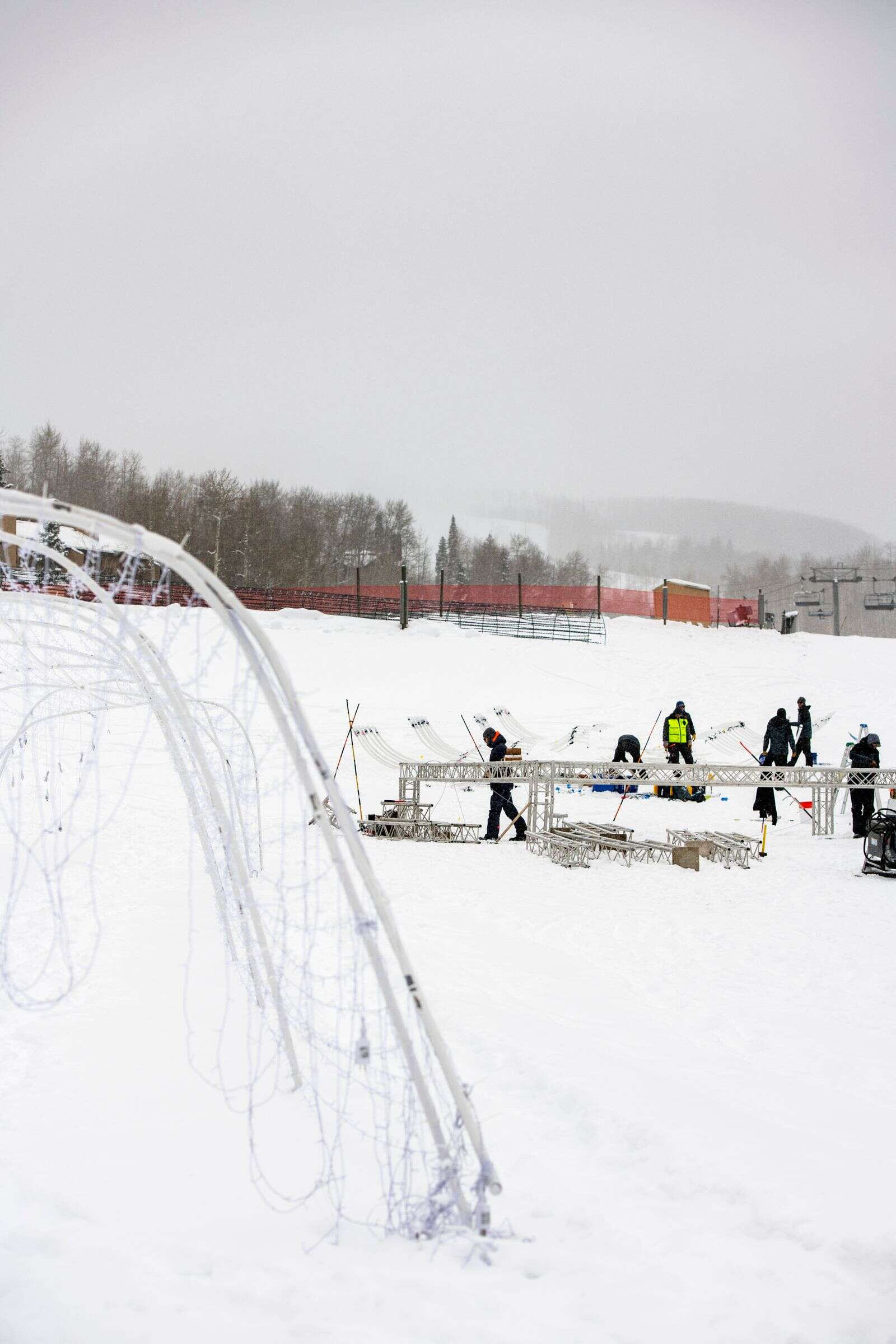 Construction on the lighting installments for the light festival in Snowmass Village on Monday, Dec. 14, 2020. (Kelsey Brunner/The Aspen Times)
