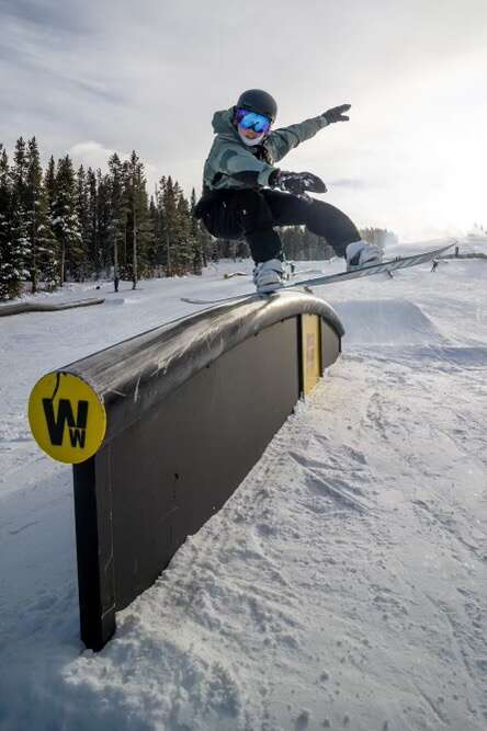 Team Summit snowboarder Ellie Weiler executes a front lipslide on a rail at Copper Mountain Resort. | Photo by Josh Underwood