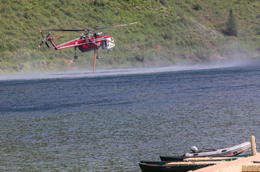 A Sikorsky S-64 Skycrane helicopter fills from Sylvan Lake to fight the Sylvan Fire Thrusday at Sylvan Lake State Park outside of Eagle.  | Chris Dillmann/cdillmann@vaildaily.com