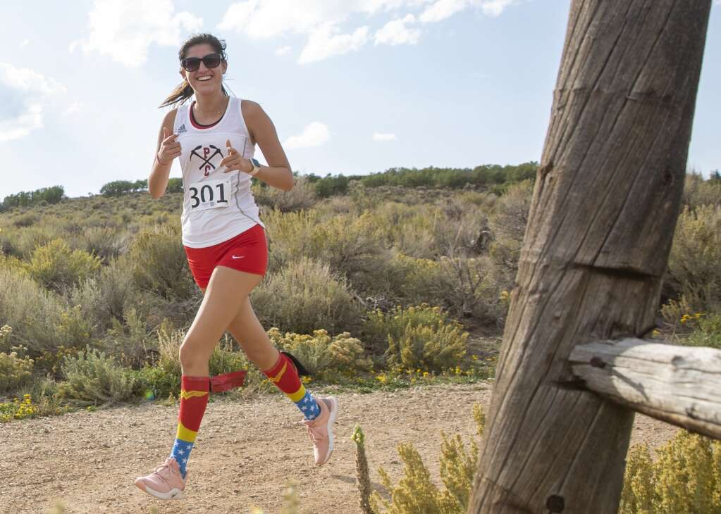 Leila Arbabi keeps the mood light on the trail during the final mile of the Park City High School invitational cross country meet in Round Valley Friday afternoon, Sept. 10, 2021. (Tanzi Propst/Park Record)
