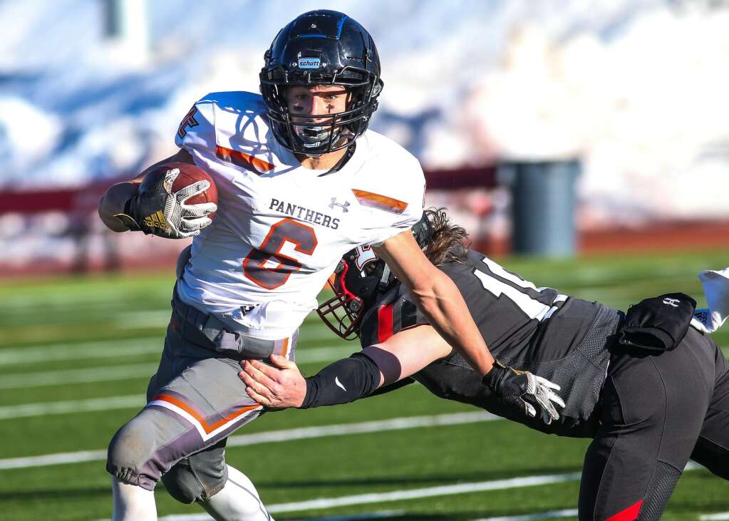 Montezuma-Cortez football player Kyler Krob evades a tackle against Aspen on Friday, April 2, 2021, on the AHS turf. (Photo by Austin Colbert/The Aspen Times)
