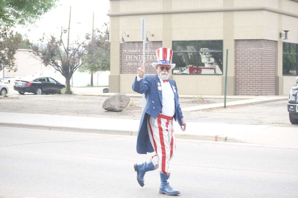 Danny Griffith, as Uncle Sam, walks in Craig's Fourth of July parade, held July 5, 2021, marched down Victory Way Monday morning. | Cuyler Meade / Craig Press