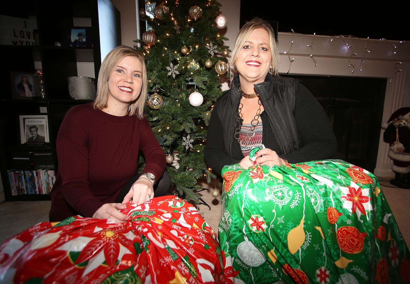 Savannah's Angels co-founders Crystal Grauke (left) and Cynthia Prout hold bags full of gifts slated for children in the community this year. The two are looking for some last minute angels to help out with some families in need this holiday.   Photo: Elias Funez
