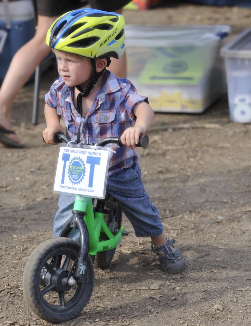 A Tot rider watches races from his bike at the Town Challenge Emerald Endurance race on Wednesday evening. (Photo by Shelby Reardon)