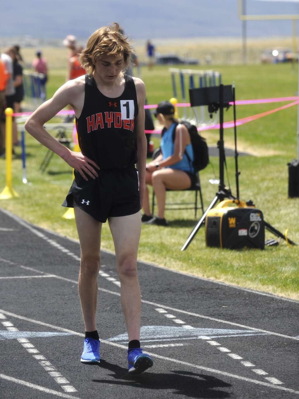 Hayden's Kale Johnson recovers from the 1600 race at the Clint Wells Invitational in Craig on Friday. (Photo by Shelby Reardon)