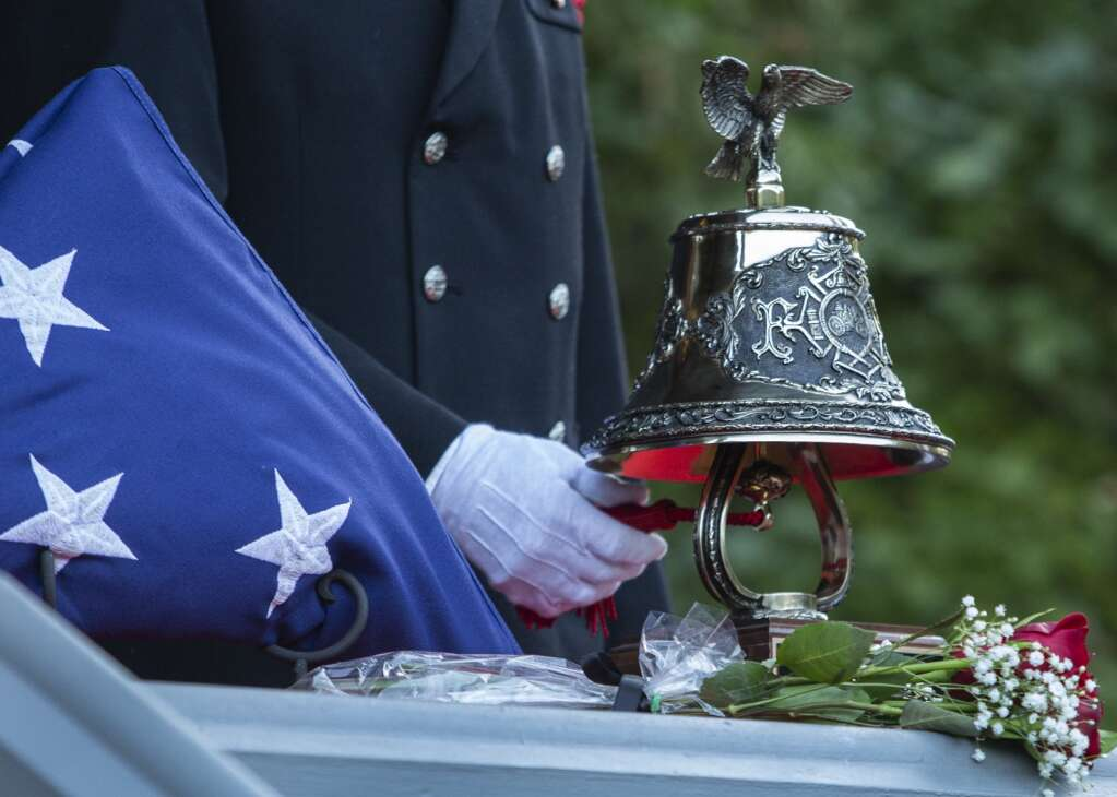 A bell was rung during a ceremony in City Park on Saturday morning honoring the 20th anniversary of the Sept. 11 attacks. (Tanzi Propst/Park Record)