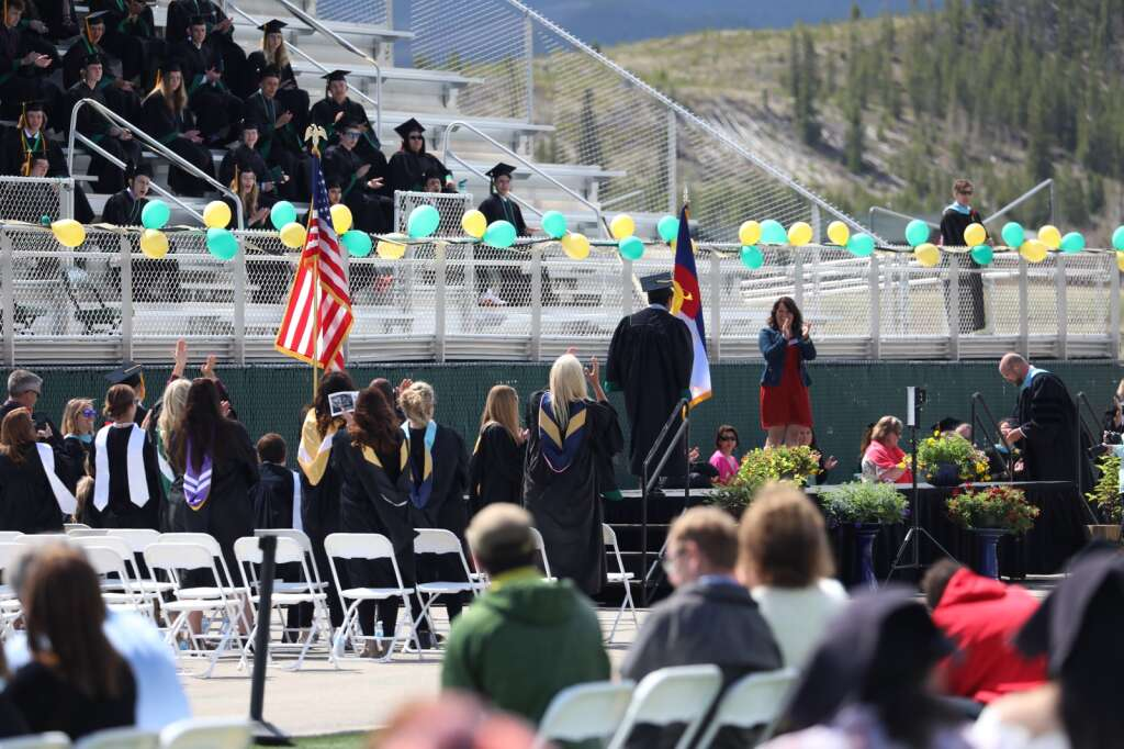 Students from the Summit High School class of 2021 walk across the stage during a graduation ceremony Saturday, May 29, in Breckenridge.   Photo by Ashley Low