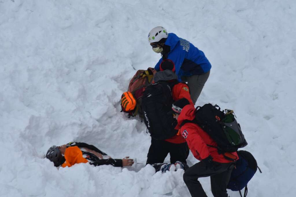 Rescuers dig up a dummy buried under the snow. | Photo by Sawyer D'Argonne / sdargonne@summitdaily.com