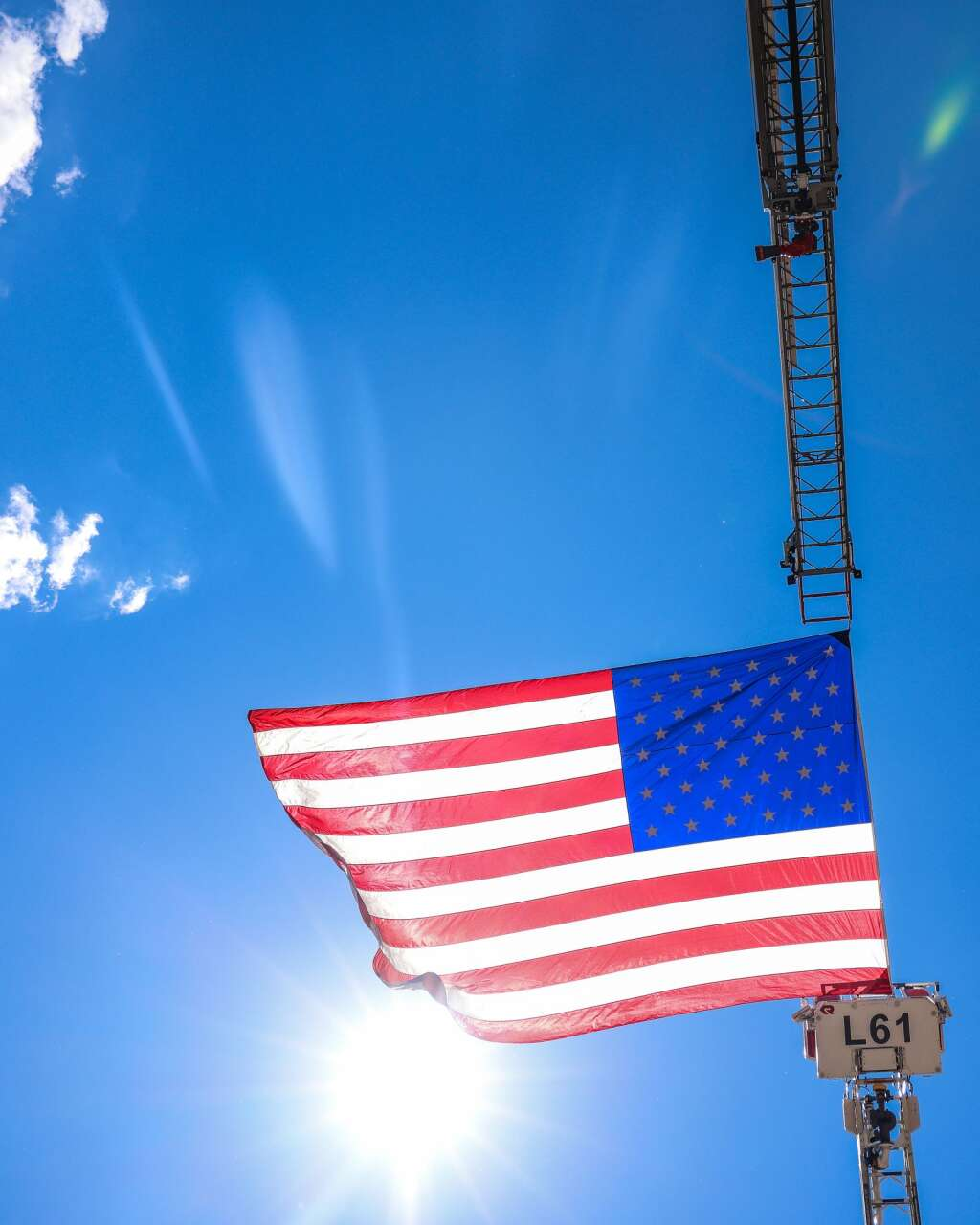 The American Flag is flown from the top of a firetruck's ladder during the Fourth of July celebration on Sunday, July 4, 2021, in downtown Aspen. Photo by Austin Colbert/The Aspen Times.