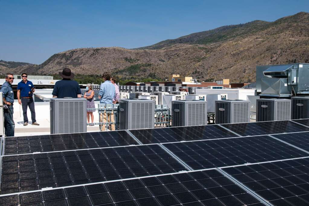 Eight cold-climate heat pumps on the roof of Skico's new affordable housing building provide the hot water to 43 apartments. A tour highlighted the high-tech system on Thursday, Sept. 9, 2021. (Kelsey Brunner/The Aspen Times)