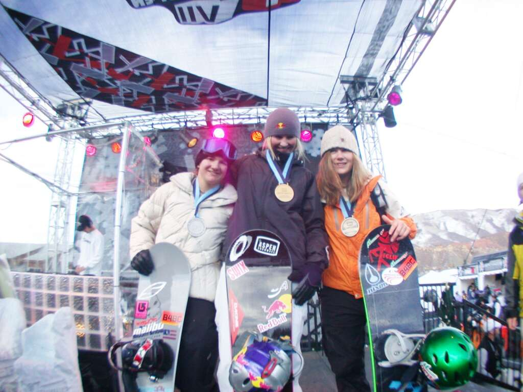 Coolio presents medals to women's snowboarding superpipe medalists Kelly Clark (silver), Gretchen Bleiler (gold) and Hannah Teter (bronze) during Winter X Games VII in Aspen. Photo courtesy of ESPN.