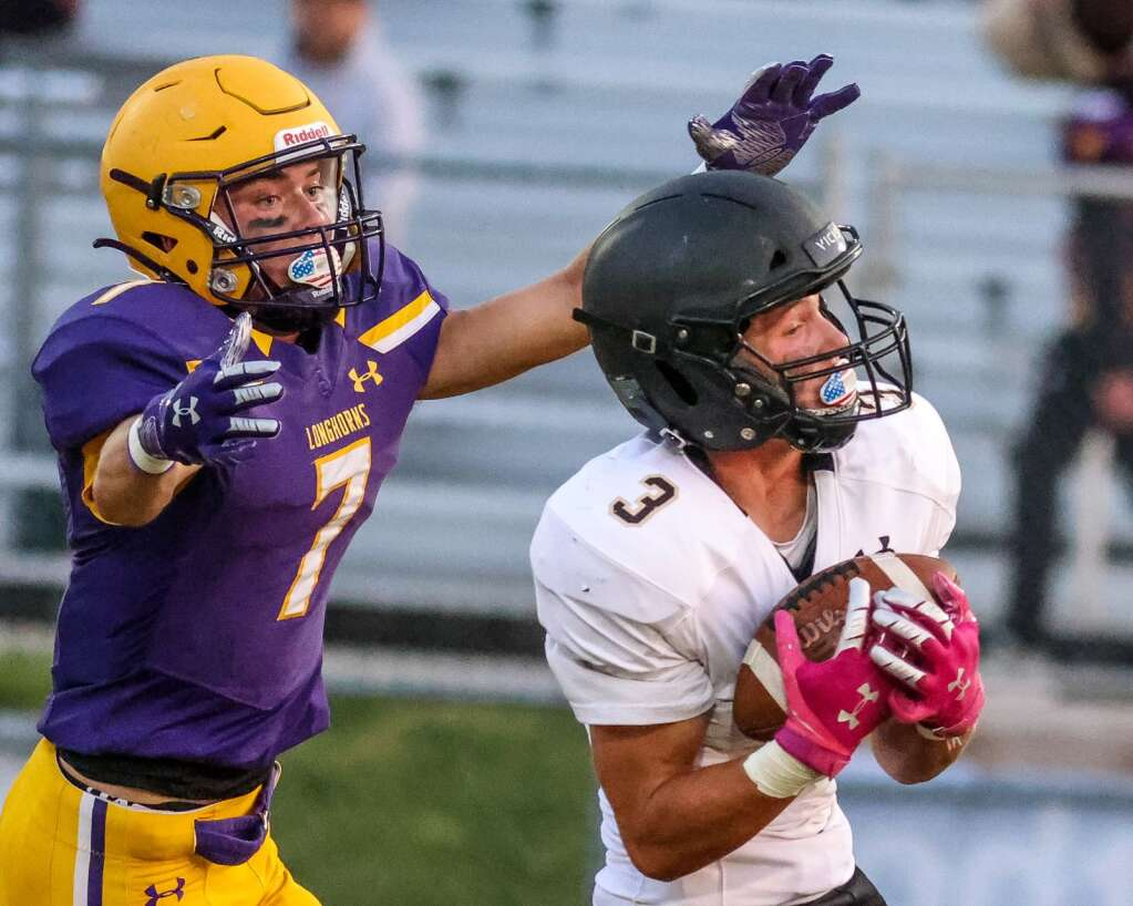 Basalt High School's Wilson Maytham, left, can't keep up with Battle Mountain wideout Tanner Roberts after he makes a catch on Thursday, Sept. 2, 2021, on the BHS field. | Photo by Austin Colbert/The Aspen Times