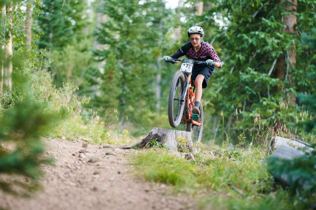 Breckenridge's Carter Niemkiewicz shaves precious seconds by taking the fast (and fun) line through a corner at the Peaks Trail Time Trial on Wednesday, Aug. 25. | Photo by John Hanson