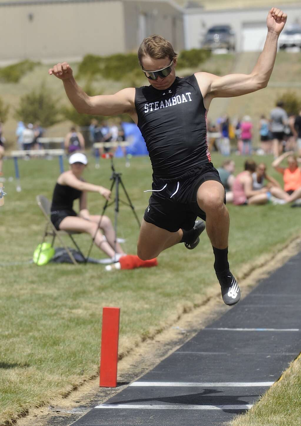 Steamboat Springs senior Jameson Tracy competes in long jump at the Clint Wells Invitational in Craig on Friday. (Photo by Shelby Reardon)
