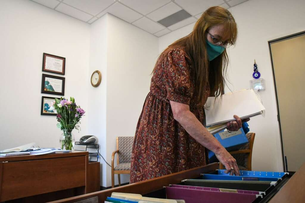 Mind Springs Health Business Services Manager Kathy Fitzgerld unpacks and puts away files in her new office at the new location 2802 S. Grand Avenue. |Chelsea Self / Post Independent