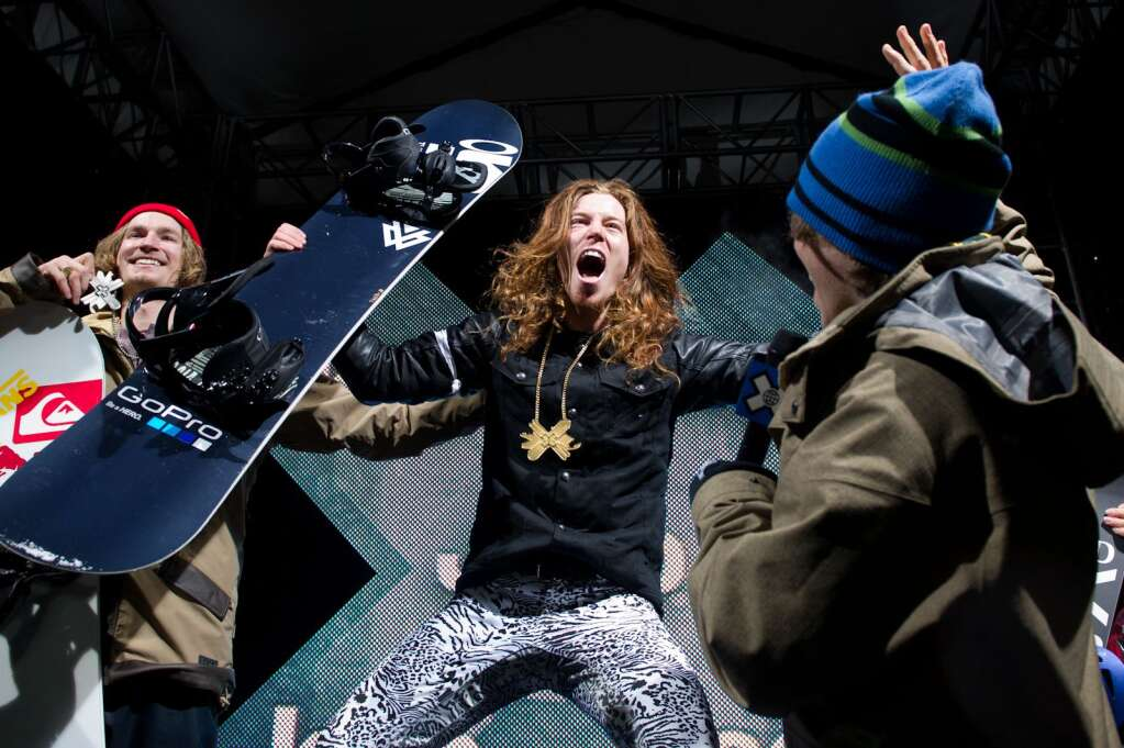 Shaun White celebrates his gold medal at the men's snowboard superpipe award ceremony during Winter X Games Aspen 2012. Photo courtesy of ESPN.