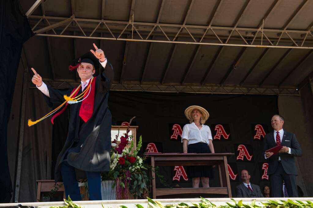 An Aspen High School graduate dances across stage as his name is called during the commencement ceremony at the football field on Saturday, June 5, 2021. (Kelsey Brunner/The Aspen Times)