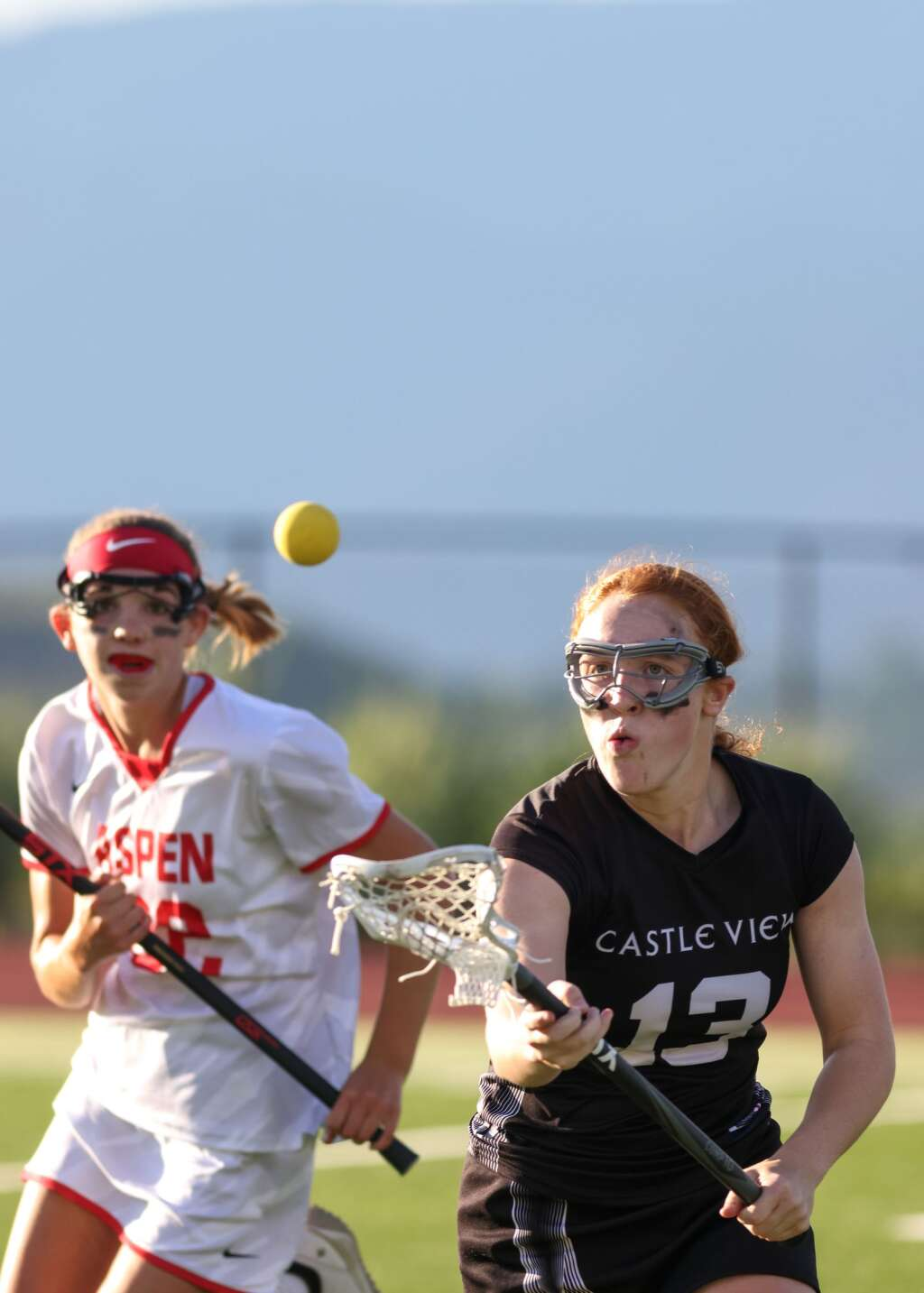 Aspen High School's Michaela Kenny, left, defends in the girls lacrosse game against Castle View in the Class 4A state quarterfinals on Saturday, June 19, 2021, on the AHS turf. The Sabercats won, 10-9. Photo by Austin Colbert/The Aspen Times.