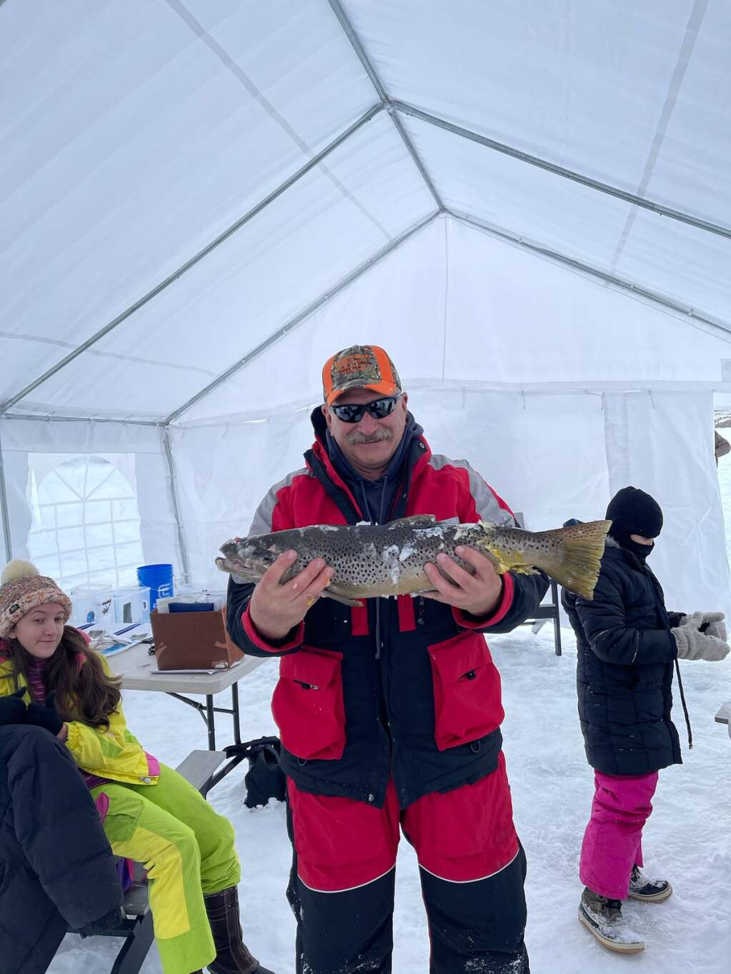 Tom Moe shows off his 41.5 inch brown at the Wolford Ice Fishing Tournament. The measurement combines length and girth. | Courtesy Tara Sharp